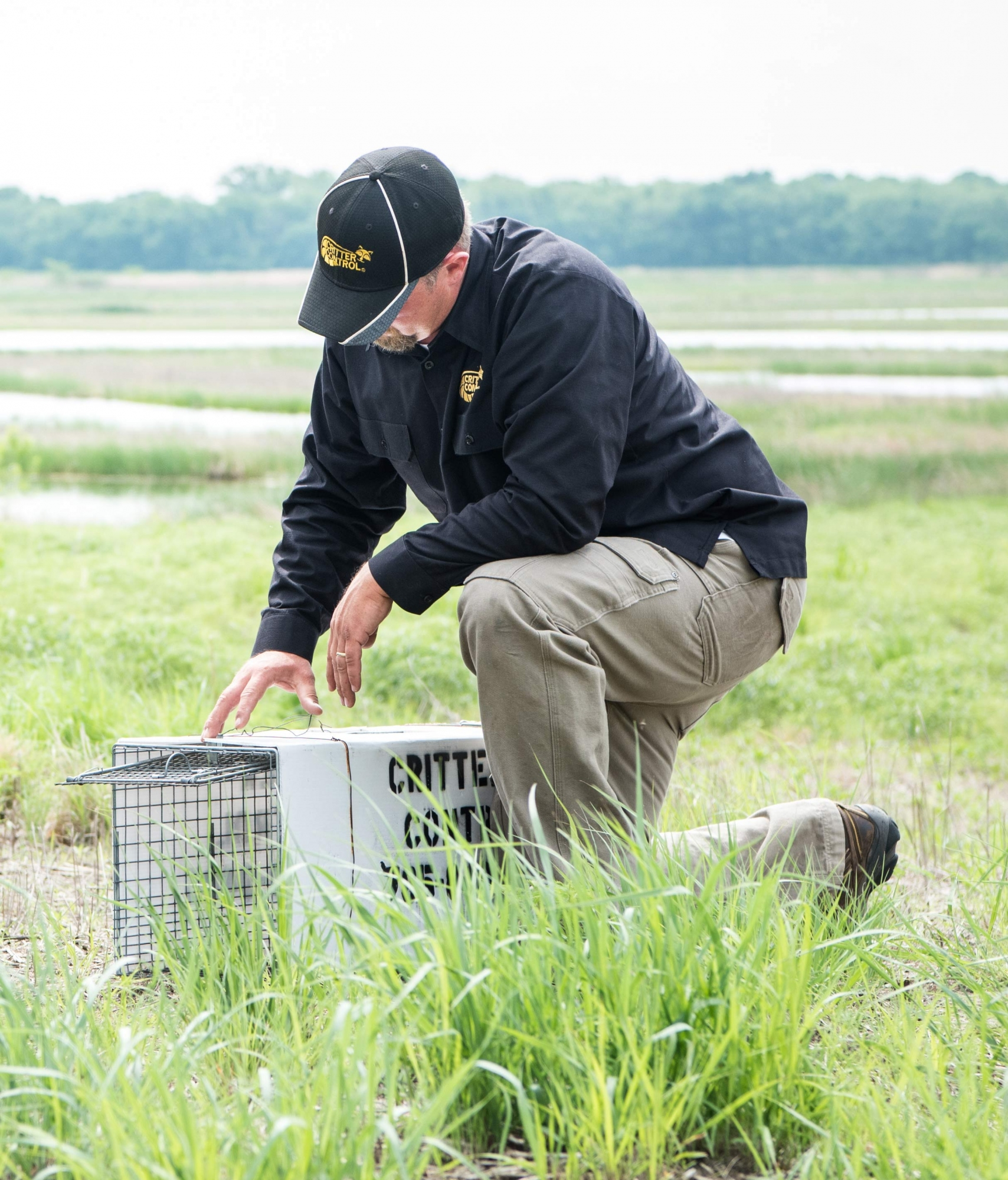 Critter Control of Kaw Valley Owner with Wildlife Live Trap